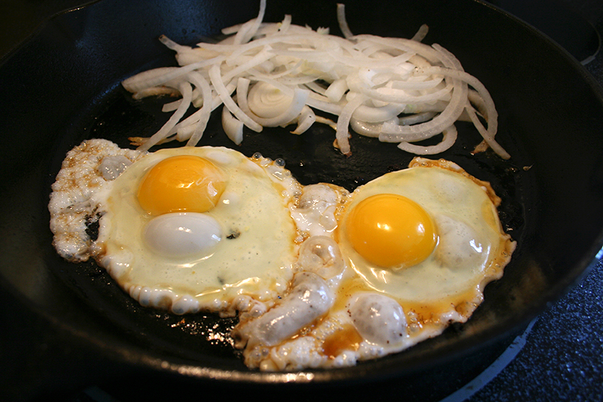 Cooking eggs and onions