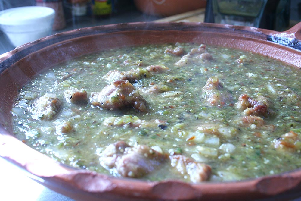 Pork Cooking in Salsa Verde